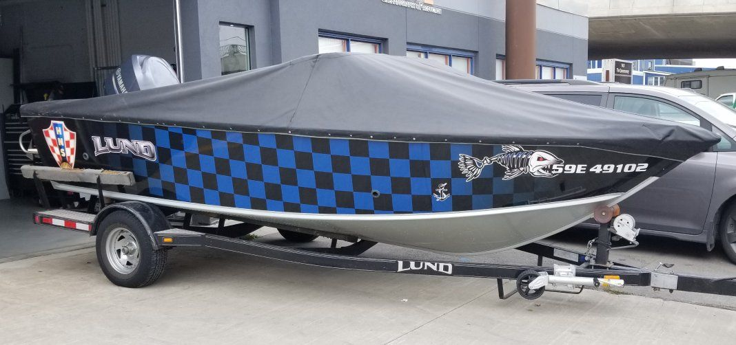 side view of a boat with custom lettering